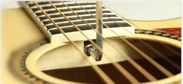你的木吉他琴颈因自然环境弯曲了?
